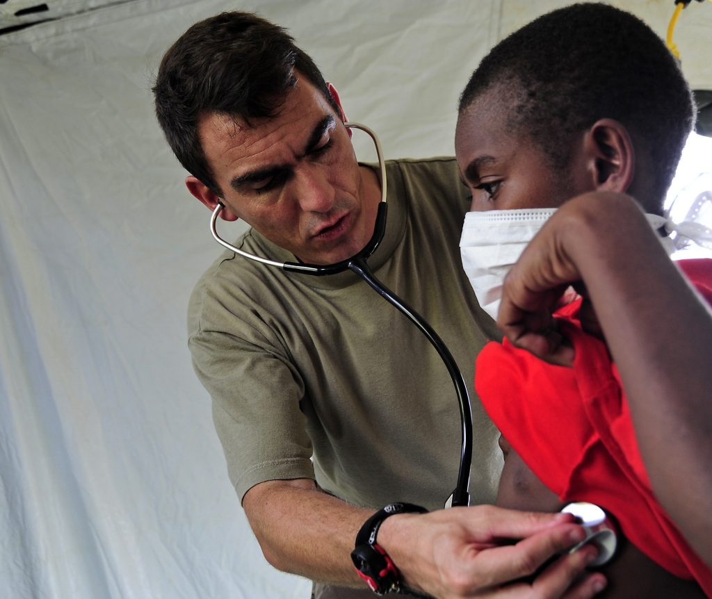 French navy emergency practitioner Lt. Cmdr. Christophe Bombert uses a stethoscope to examine a Papua New Guinean child at the Wampar medical civic action project during Pacific Partnership 2011 in Lae, Papua New Guinea, May 23, 2011. Pacific Partnership is an annual deployment of forces designed to strengthen maritime and humanitarian partnerships during disaster relief operations, while providing humanitarian, medical, dental and engineering assistance to nations of the Pacific. (U.S. Air Force photo by Tech. Sgt. Tony Tolley/Released)